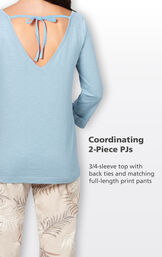 Solid light blue 3/4-sleeve top with back ties and matching full-length print pants image number 3