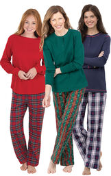 Models wearing Christmas Tree Plaid Pajamas, Snowfall Plaid Pajamas and Stewart Plaid Thermal-Top Pajamas.