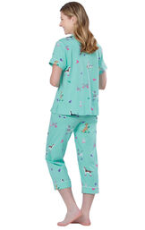 Model wearing Light Blue Dog Print Short Sleeve Button-Front Capri PJ for Women, facing away from the camera image number 1