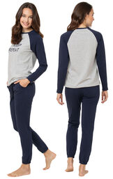 Model wearing Sunday Funday Pajamas - Navy (eat/sleep), facing away from the camera and then to the side image number 1