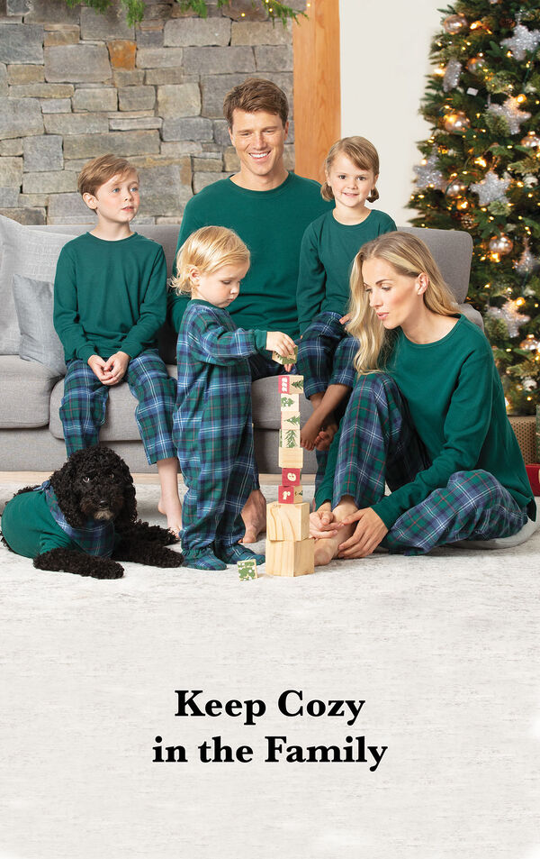 "Family wearing Heritage Plaid Matching Family Pajamas. Headline: ""Keep Cozy in the Family"" image number 1"