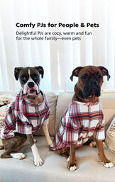 Two dogs sitting on couch wearing Red and White Plaid Fireside Fleece PJs with the following copy: Comfy PJs for People and Pets - delightful PJs are cozy, warm and fun for the whole family- even pets image number 2