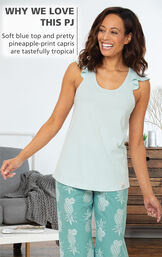 WHY WE LOVE THIS PJ: Soft blue top and pretty pineapple-print capris are tastefully tropical image number 2