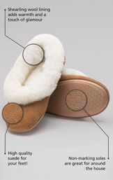 Details of the slippers highlighted which include a shearling wool lining that adds warmth and a touch of glamour, high quality suede for your feet and non-marking soles that are great for around the house image number 1