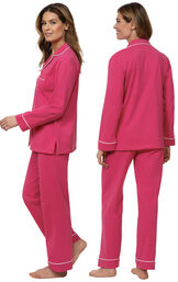 Model wearing bold pink button-front pajamas, facing away from the camera and then to the side image number 1