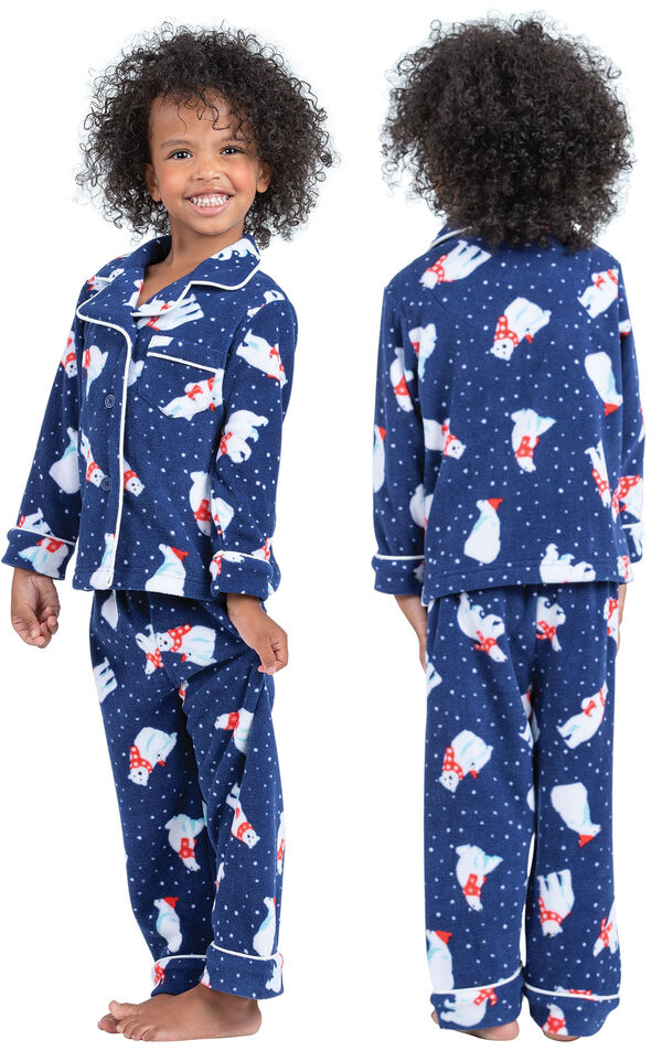 Model wearing Navy Polar Bear Fleece Button-Front PJ for Toddlers, facing away from the camera and then facing to the side image number 1