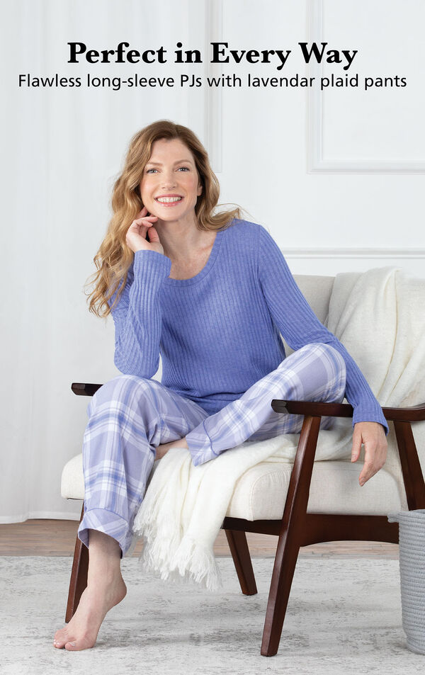 Model wearing Lavender Plaid World's Softest Flannel Pullover Pajamas, sitting on a chair image number 3