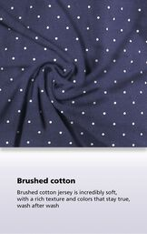 Navy Polka-Dot fabric with the following copy: Brushed cotton jersey is incredibly soft, with a rich texture and colors that stay true, wash after wash. image number 3