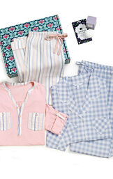 Periwinkle Blue Gingham Boyfriend PJs & Pink and Blue striped Henley PJs in a blue and pink floral box with a bath bomb image number 1