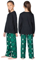 Model wearing Black and Green Snowman Argyle Henley PJ for Girls, facing away from the camera and then to the side image number 1