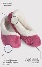 Close up of the Pink World's Softest Slipper with the following copy: High quality plush lining adds warmth and a touch of glamour. Non-marking soles are great for around the house. The softest pile fleece and an extra-padded footbed image number 1