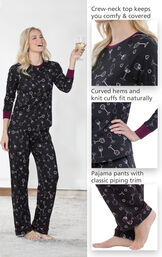 Model wearing Wine Down Pajamas holding a glass of wine with close-ups of the following details: Crew-neck top keeps you comfy and covered, Curved hems and knit cuffs fit naturally, Pajama Pants with classic piping trim image number 3