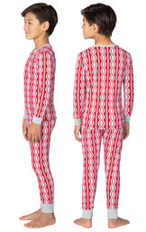 Model wearing Red and White Peppermint Twist PJ for Kids, facing away from the camera and then to the side image number 1