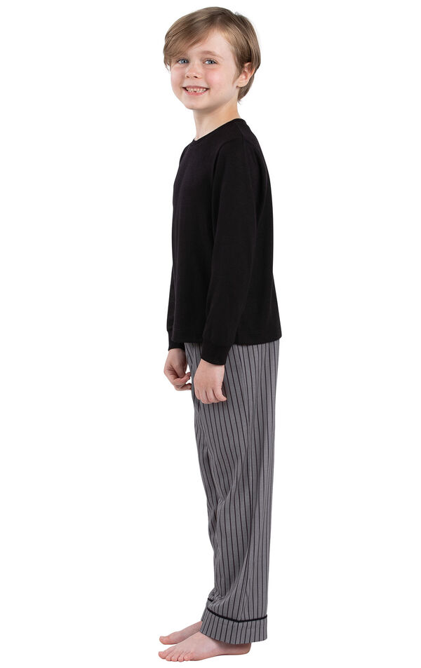 Model wearing Charcoal Gray and Black Stripe PJ for Youth, facing to the side image number 2