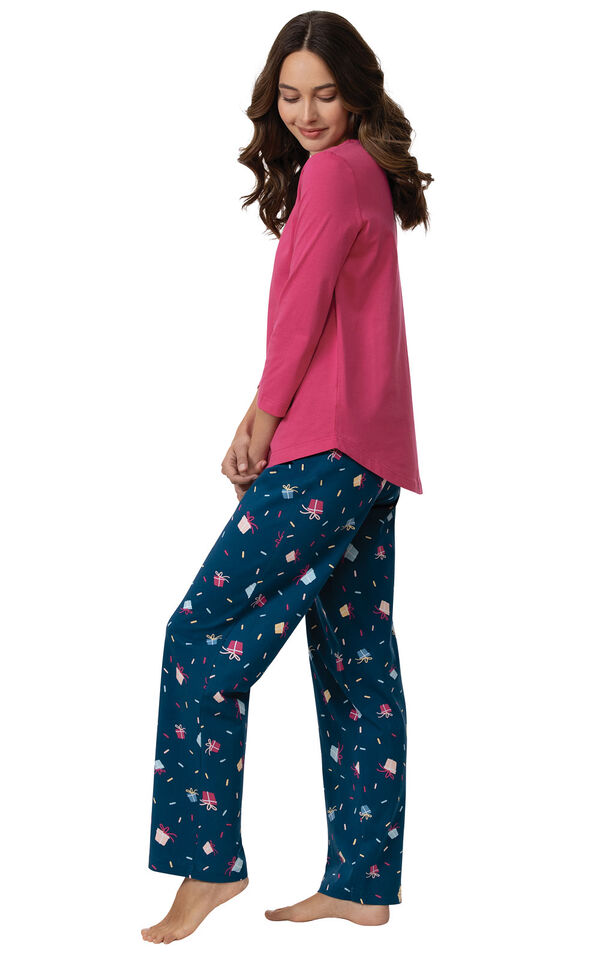 Model wearing Navy and Pink Present Print PJs, facing to the side image number 1