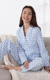 Model sitting on couch with blanket wearing Periwinkle Heart2Heart Gingham Boyfriend Pajamas image number 3