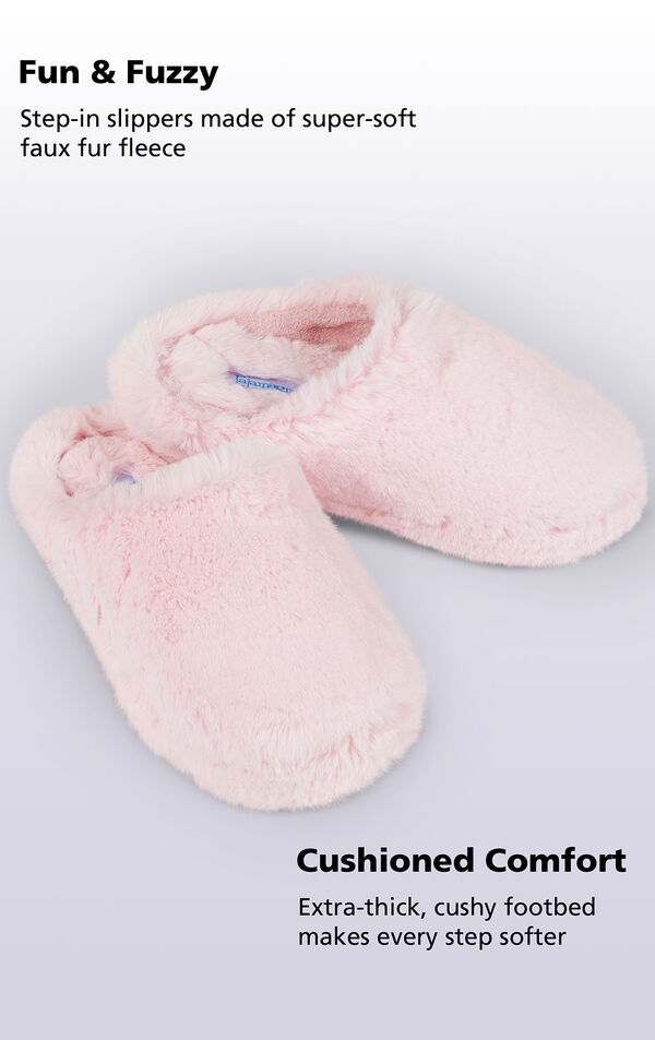Pink Fuzzy Wuzzies slippers with the following copy: step-in slippers made of super-soft faux fur fleece. Extra-thick, cushy footbed makes every step softer image number 1