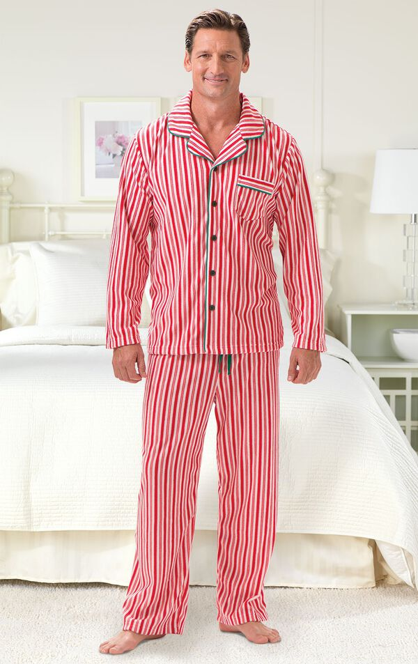 Model standing by bed wearing Red and White Striped Candy Cane Fleece Men's Pajamas  image number 1