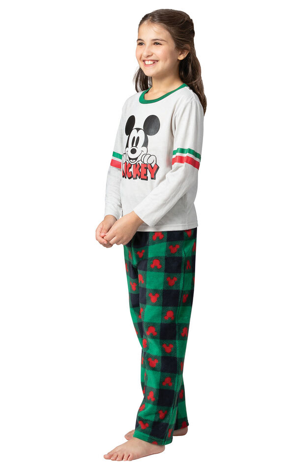 Model wearing Red and Green Mickey Holiday Pajamas for Girls, facing to the side image number 1