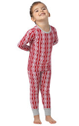 Model wearing Red and White Peppermint Twist PJ for Toddlers