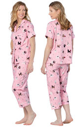 Model wearing Pink Kitty Print Short Sleeve Button-Front Capri PJ for Women, facing away from the camera and then to the side image number 1