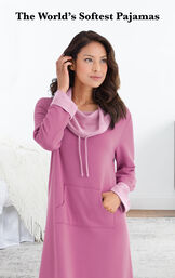 Model wearing World's Softest Nighty - Raspberry by bed with the following copy: The World's Softest Pajamas image number 2