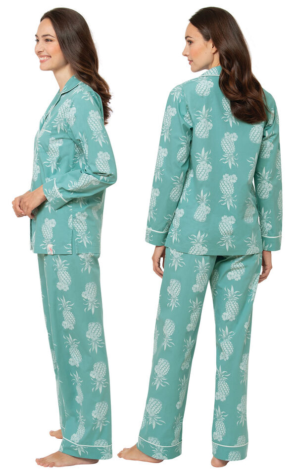 Model wearing Turquoise Pineapple Margaritaville Boyfriend Pajamas, facing away from the camera and then facing to the side image number 1
