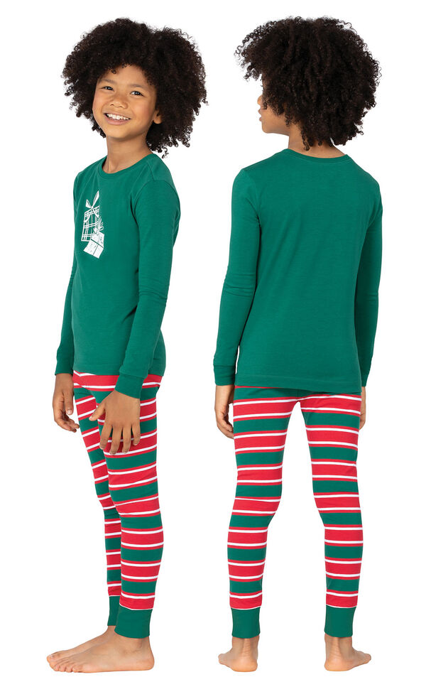 Model wearing Red and Green Christmas Stripe PJ for Kids, facing away from the camera and then to the side image number 1