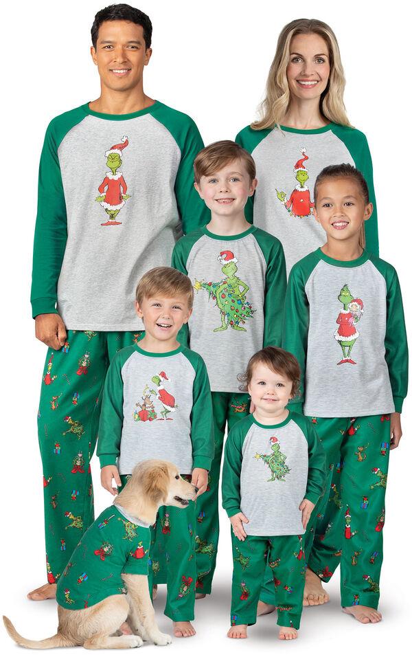 Models wearing Green and Gray Holiday Grinch Matching Family Pajamas image number 0