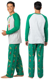 Model wearing Green and Gray Grinch PJ for Men, facing away from the camera and then to the side image number 1