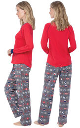 Model wearing Red and Blue Justice League PJ for Women, facing away from the camera and then to the side image number 1