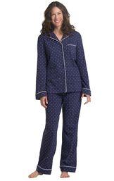 Model wearing navy blue polka-dot women's pajama