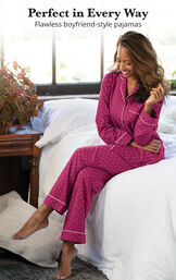 Model sitting on bed wearing Fuchsia Classic Polka-Dot Boyfriend Pajamas with the following copy: Perfect in Every Way - Flawless boyfriend-style pajamas image number 2