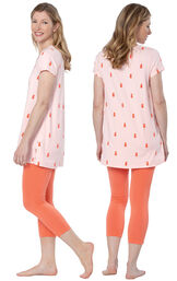 Model wearing Short Sleeve and Legging Pajamas - Coral, facing away from the camera and then to the side image number 1
