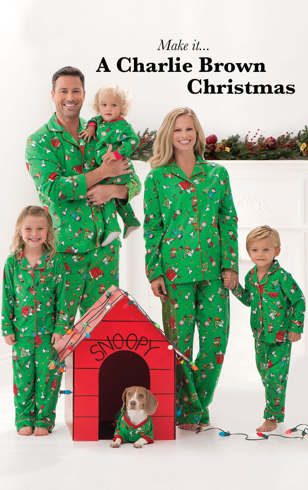 Family standing around doghouse, all wearing Green Charlie Brown Matching Christmas Pajamas image number 1