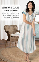 Model by chair wearing Margaritaville Cabana Striped Nighty - Blue/White with the following copy: Ocean-blue stripes and trim evoke a sense of paradise at bedtime image number 2