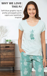 WHY WE LOVE THIS PJ: Soft blue graphic top and pretty pineapple-print capris are tastefully tropical image number 2
