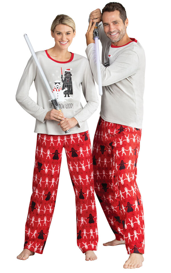 Models wearing Red Star Wars PJs for Him and Her image number 0