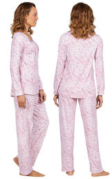 Model wearing Pink Print Tie-Neck PJ for Women, facing away from the camera and then to the side image number 1