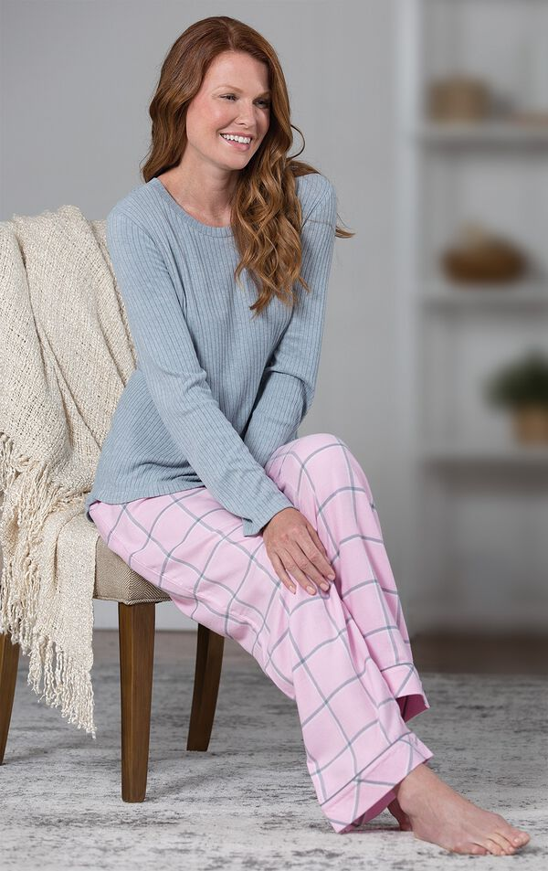 Model sitting on chair wearing Pink and Gray World's Softest Flannel Pajamas image number 3