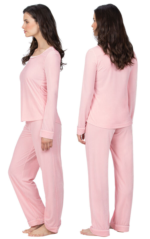 Model wearing Pink Velour PJ with Satin Trim for Women, facing away from the camera and then to the side image number 1