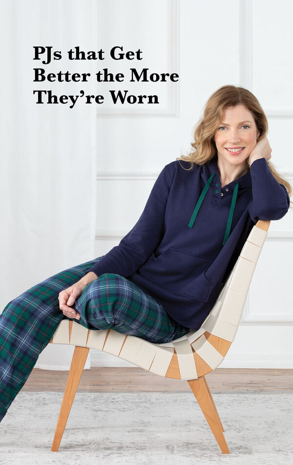 Model sitting on chair wearing Heritage Plaid Hooded Women's Pajamas with the following copy: PJs that get better the more they're worn image number 2