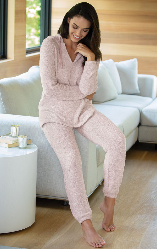 Model sitting on couch wearing Cozy Escape Pajamas - Pink image number 2