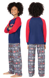 Model wearing Red and Blue Justice League PJ for Kids, facing away from the camera and then to the side image number 1