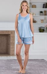 Model standing by fireplace wearing Light Blue with Pink Trim Dreamy Satin Short Set image number 4