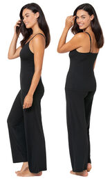 Model wearing Naturally Nude Cami Pajamas - Black, facing away from the camera and then facing to the side image number 1