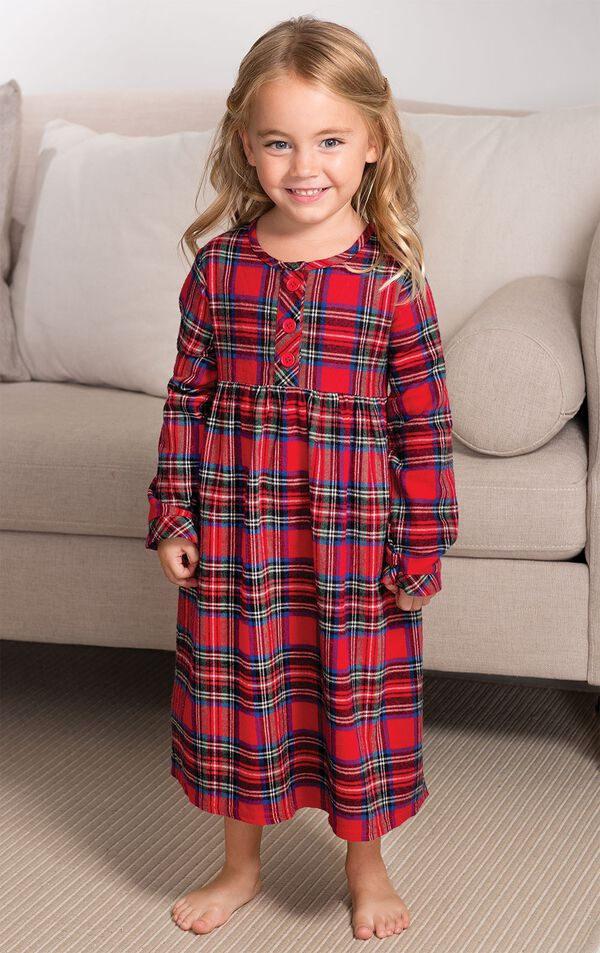 Toddler girl standing by couch wearing Steward Plaid Flannel Toddler Nighty image number 4