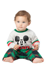 Model sitting on ground wearing Red and Green Mickey Mouse Holiday Pajamas for Infants