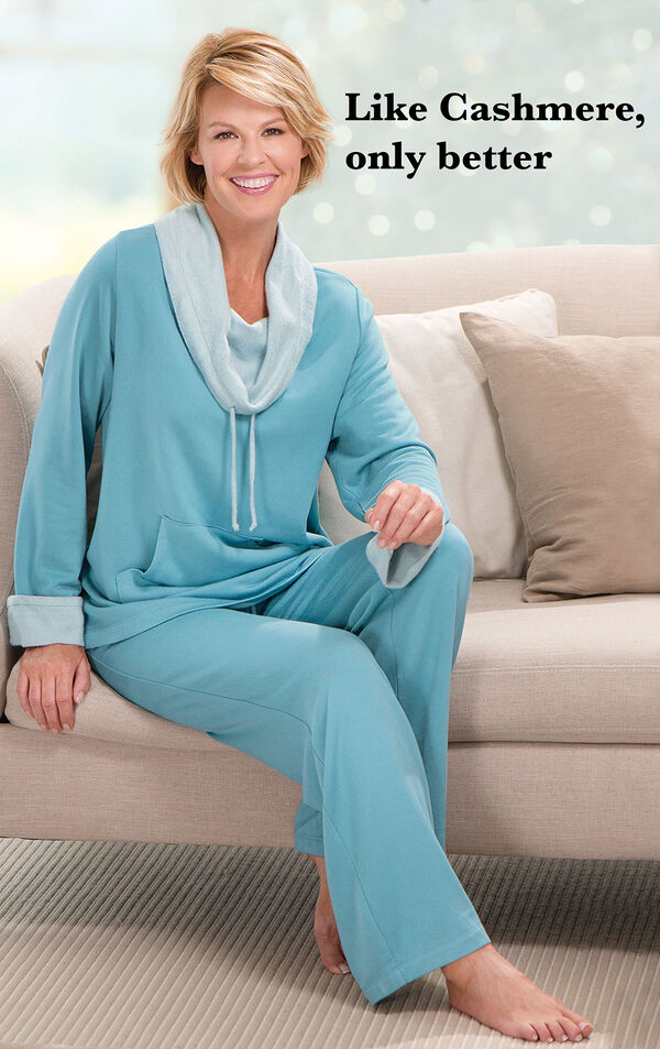 Model wearing Teal World's Softest Pajamas sitting on a couch with the following copy: Like Cashmere, only better image number 1