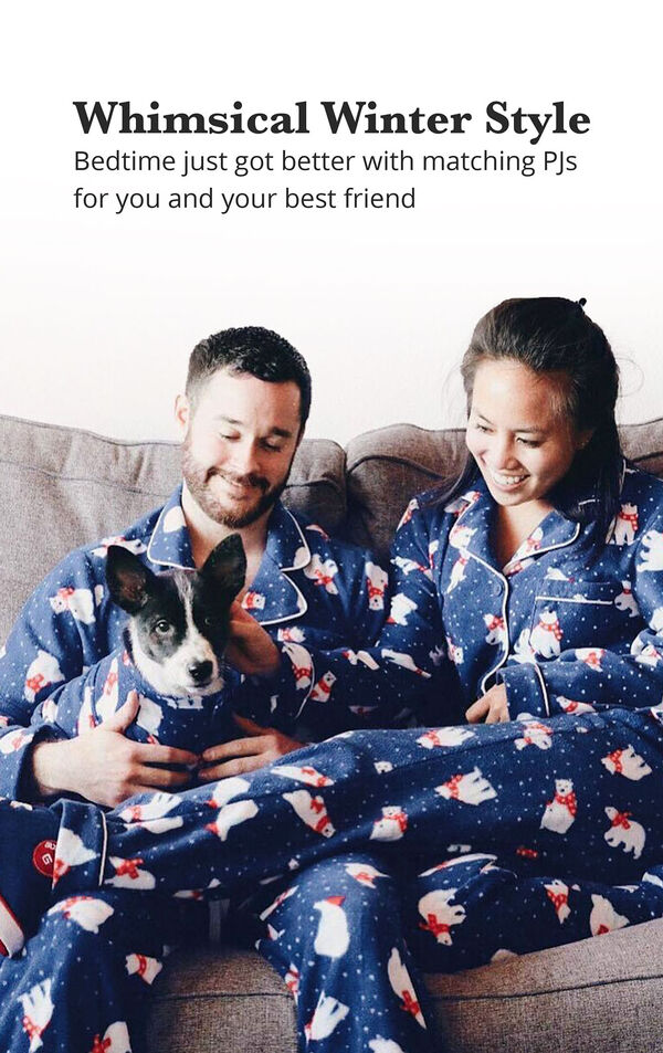 Pet and Owners sitting on couch wearing matching Polar Bear Fleece Pajamas - Bedtime just got better with matching PJs for you and your best friend image number 1